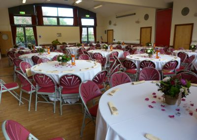 Table set up with flowers in the Gates Hall